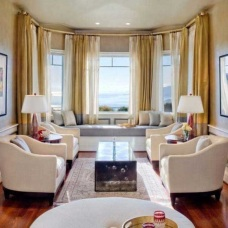 Дизайн интерьера гостиной с эркером для оформления полезной зоны