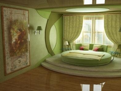 дизайн интерьера в зеленых тонах с круглой кроватью